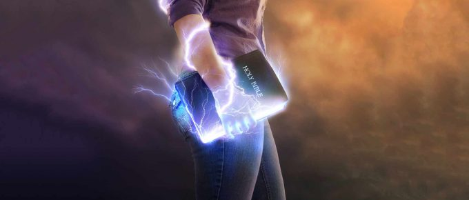 Person holding Bible walking and lighting coming out fo the bible.