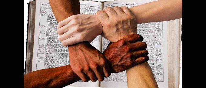 Four hands held over the holy bible. Represents trust.